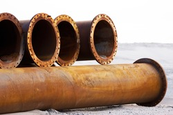 Corroded pipelines, used for land reclamation, on a beach, Holland