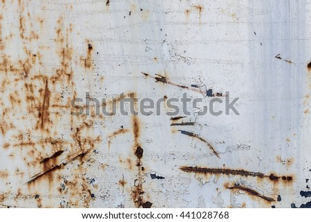Corroded white metal background. Rusted white painted metal wall. Rusty metal background with streaks of rust. Rust stains. The metal surface rusted spots. rust corrosion.\n