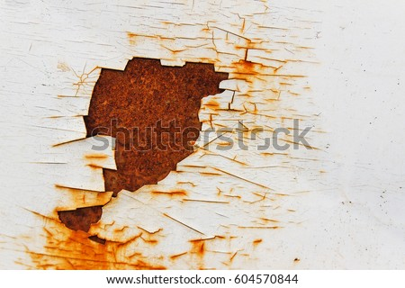 Corroded white metal background. Rusted white painted metal wall. Rusty metal background with streaks of rust. Rust stains. The metal surface rusted spots. Rysty corrosion.