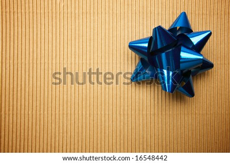 Corrugated Gift Box with a Blue Bow.