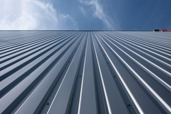 Corrugated iron sheet, aluminum Facade of a warehouse as background texture
