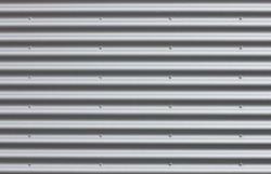 Corrugated iron wall with blanks.