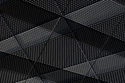 Corrugated metal structure resembling ribbed walls of industrial building. Abstract modern architecture background. Polygonal geometric pattern of crossed and parallel lines. Striped texture surfaces.