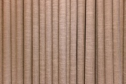 Corrugated pattern and textured of the brown fabric curtains or the drape inside the room with interior decoration