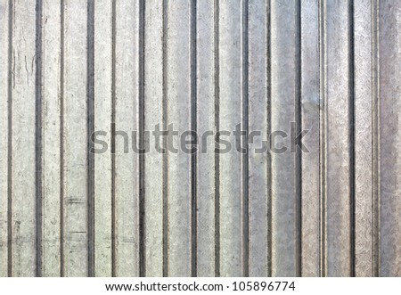 Corrugated zinc metal texture may be used as background