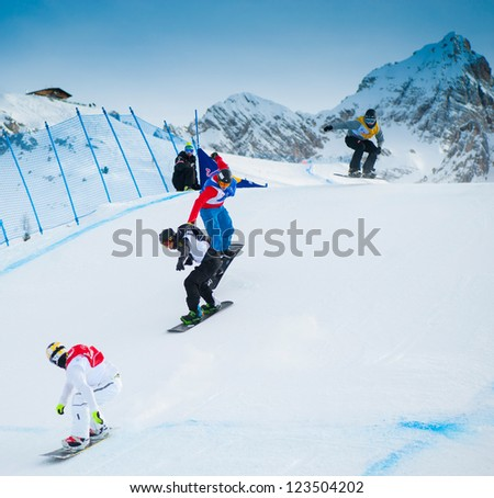 CORTINA D'AMPEZZO, ITALY - DECEMBER 22: Unknown snowboarders performs during the European Cup Snowboardcross on December 22, 2012, Cortina d'Ampezzo, Italy