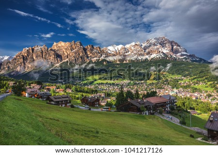 Cortina d'Ampezzo town panoramic view with alpine green landscape and massive Dolomites Alps in the background. Province of Belluno, South Tyrol, Italy. Foto stock ©