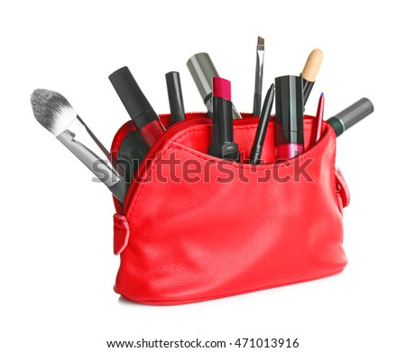 Cosmetic bag with cosmetic products, isolated on white