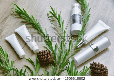 Cosmetic bottle containers packaging with green herbal leaves, Blank label for organic branding mock-up, Natural skincare beauty product concept. #1505518802
