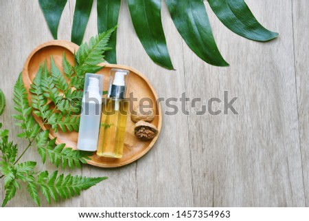 Cosmetic bottle containers with green herbal leaves, Blank label package for branding mock-up, Natural organic beauty product concept, Research and development of purified botany skincare. #1457354963