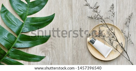 Cosmetic bottle containers with green herbal leaves, Blank label package for branding mock-up, Natural organic beauty product concept, Research and development of purified botany skincare. #1457396540