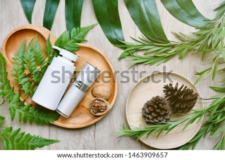 Cosmetic bottle containers with green herbal leaves, Blank label package for branding mock-up, Natural organic beauty product concept, Research and development of purified botany skincare. #1463909657