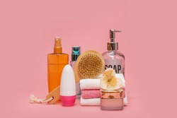 Cosmetic bottles with cosmetics for body care. Acessories for bath, towel and organic dry shampoo for personal hygiene. Daily bodycare concept, organic bath products