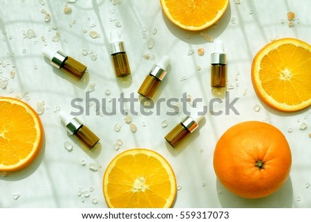 Cosmetic brown bottle containers with fresh orange slices, Blank label for branding mock-up, Natural Vitamin C beauty product concept. (Color Processed) #559317073