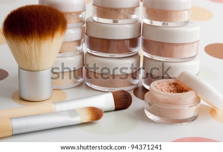 cosmetic brushes, make-up powder, blush, foundation, eyeshadow in plastic jars