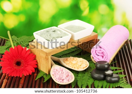 cosmetic clay for spa treatments isolated on colorful green background