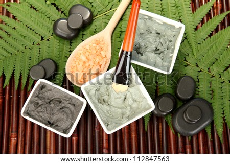 cosmetic clay for spa treatments on bamboo background close-up