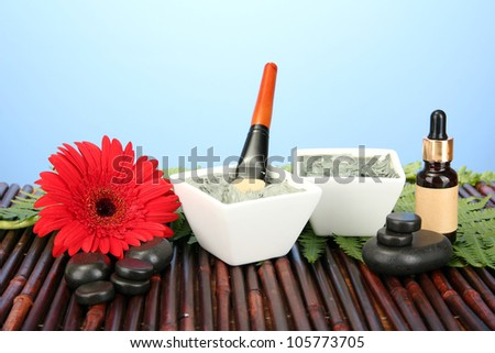 cosmetic clay for spa treatments on blue background close-up