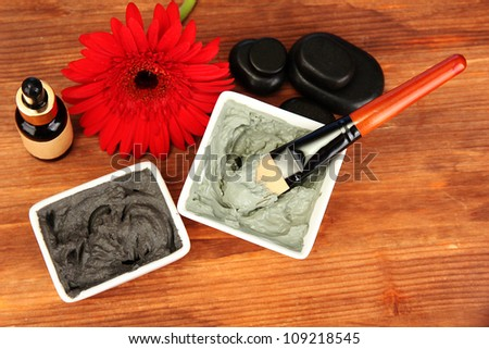 cosmetic clay for spa treatments on wooden background close-up