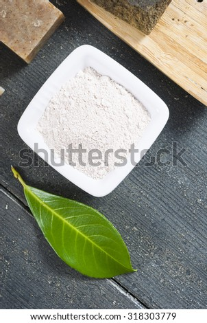 cosmetic clay on black wood table