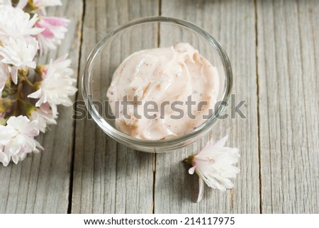 cosmetic cream on old wood background