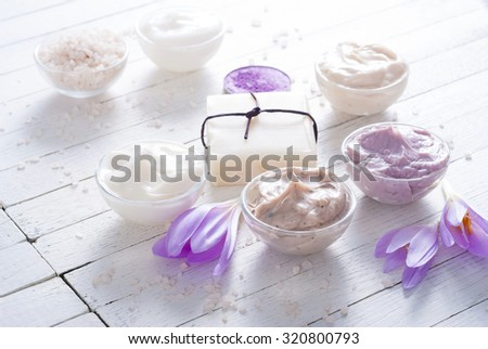 cosmetic cream variations, soap and bath salt with autumn crocus herbal flower on white wooden table