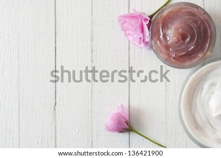 cosmetic cream with japanese cherry blossoms on white wooden table