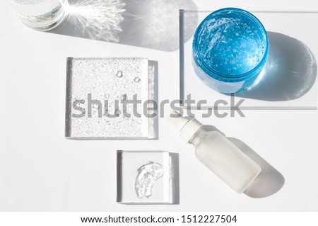 Cosmetic hydrating product or ingredient concept flat lay. Hyaluronic acid gel on the white background top view