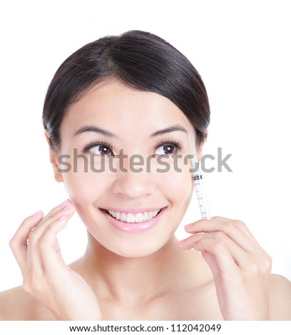 Cosmetic injection surgery to the pretty woman face and woman happy look to empty copy space isolated on white background, model is a asian beauty