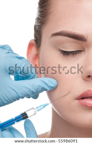 cosmetic injection to the face of beautiful woman - close-up portrait isolated on white
