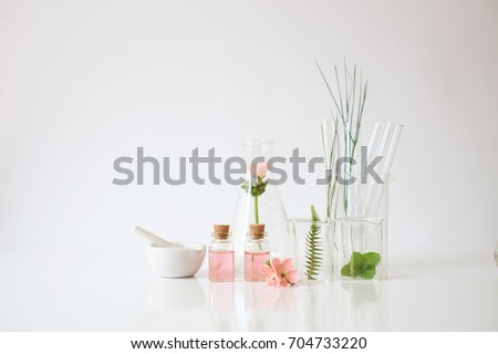 cosmetic laboratory experiment and research with leaf, oil and ingredient  extract for natural beauty  and organic skincare product package,bio science concept. alternative medicine. spa #704733220