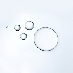 Cosmetic liquid or water serum on white background