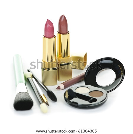 Cosmetic makeup kit with brushes isolated on white background