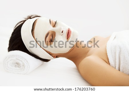 Cosmetic Mask Beautiful Young Woman Getting a Beauty Treatment in Spa Salon Isolated on White Backround