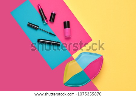 Cosmetic Minimal Makeup Set. Woman Fashion Beauty Accessories. Essentials. Trendy Design Lips Clutch Bag. Lipstick Brushes Mascara. Creative Bright Color. Pop Art Style. Flat lay.