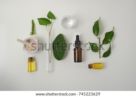Cosmetic package containers with green leaves, pink salt,herbal . natural  organic beauty product concept mock up. Blank bottle for label own branding skincare. isolated white background.top view. #745223629