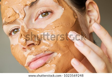 cosmetic pink clay. girl in a mask of pink clay #1023569248