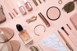 Cosmetic products and accessories on beige background, flat lay