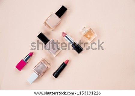 cosmetic set. Isolated on pastel background.Bottle of perfume and cosmetic products on color background.Decorative cosmetics and tools of professional makeup artist.Women's cosmetics.