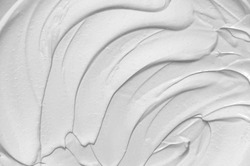 Cosmetic texture of clay. White mud mask for face and body. Abstract background