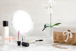 cosmetics and a mirror on the dressing table in the bathroom