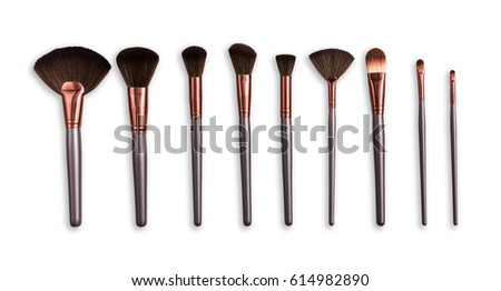 Cosmetics and beauty. Make-up brushes set in row on white isolated background #614982890