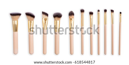 Cosmetics and beauty. Make-up brushes set in row on white isolated background #618544817