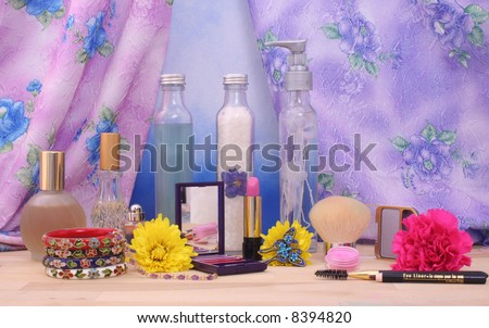 Cosmetics and Jewelry With Flowers and Perfume