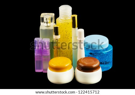 Cosmetics and perfume isolated on black background