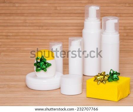 Cosmetics as a gift: different cosmetic products for body care and gift box decorated with small bows