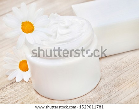 Cosmetics cream and soap with blossoms