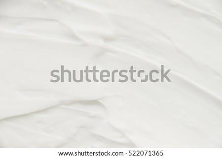 Cosmetics. Cream white background texture. #522071365