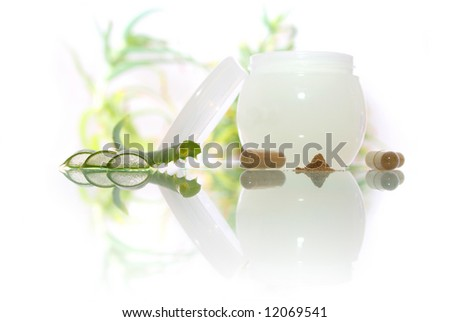 Cosmetics cream with aloe vera on the white background