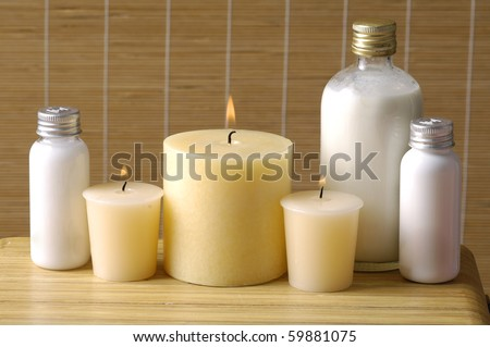Cosmetics for body, cosmetic bottle and towel on straw napkin